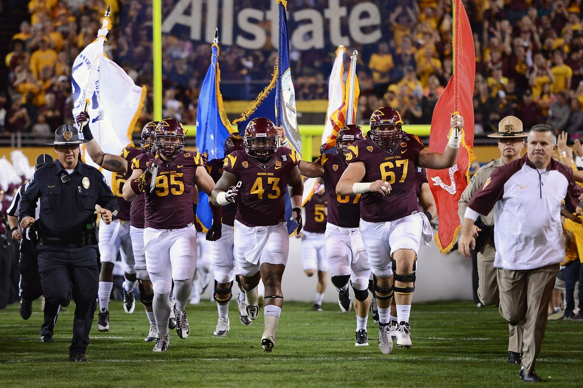 """ASU carries out the flags of each branch of the military on """"Salute to service"""" night against Oregon State."""