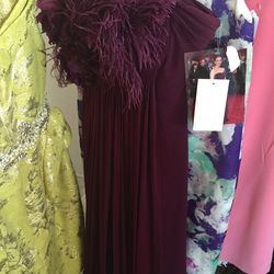 Feathered maroon gown, $900