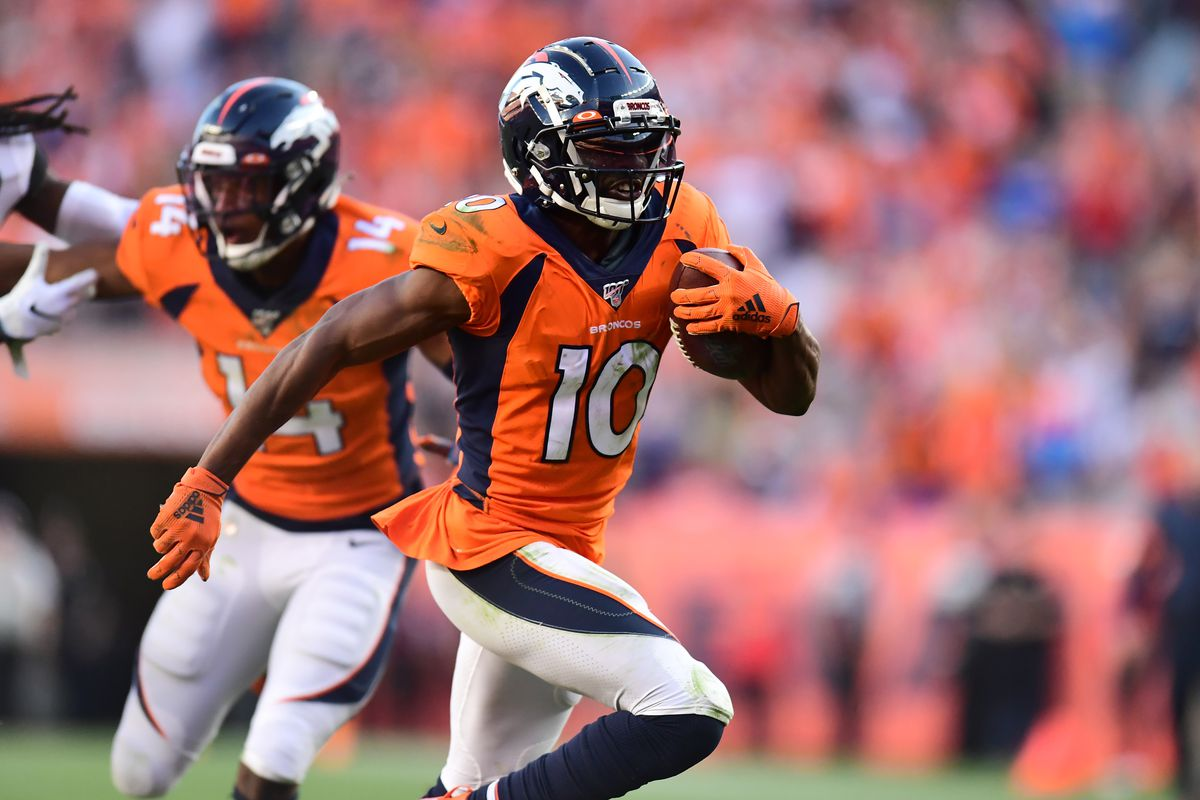 Denver Broncos wide receiver Emmanuel Sanders carries the ball in the fourth quarter against the Jacksonville Jaguars at Empower Field at Mile High.