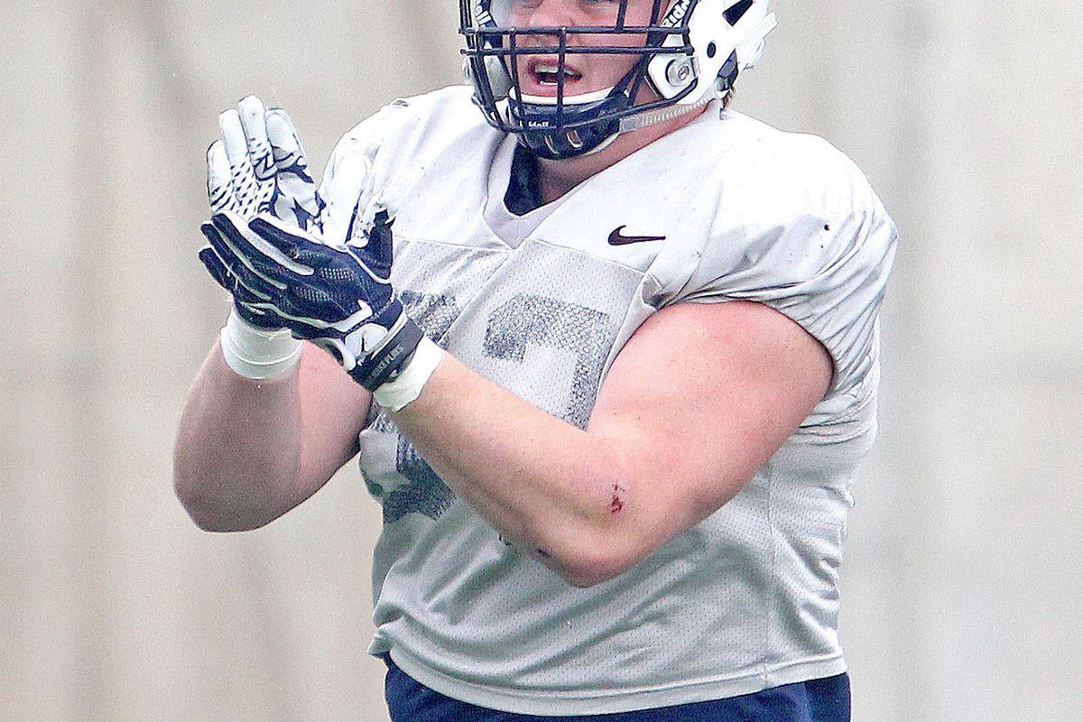 Aggie defensive end Jacoby Wildman celebrates after the USU defense recorded a quarterback sack during Friday's scrimmage at Maverik Stadium in Logan.