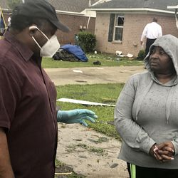 Monroe Mayor Jamie Mayo talks to a displaced resident after severe storms damaged homes in Monroe, La., Sunday, April 12, 2020.
