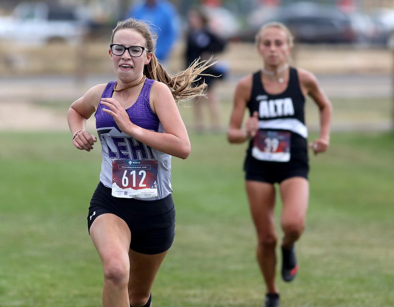 Lehi High School's Anna Martin, left, finished in first place in the girls varsity cross-country race at the Park City Invitational at Quinn's Junction Sports Complex on Friday, Sept. 27, 2019. Morgan Jensen of Alta, right, finished second.