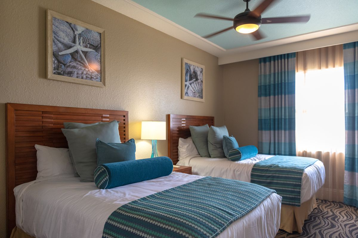 A luxurious bedroom in The Wyndham Palm-Air resort which...