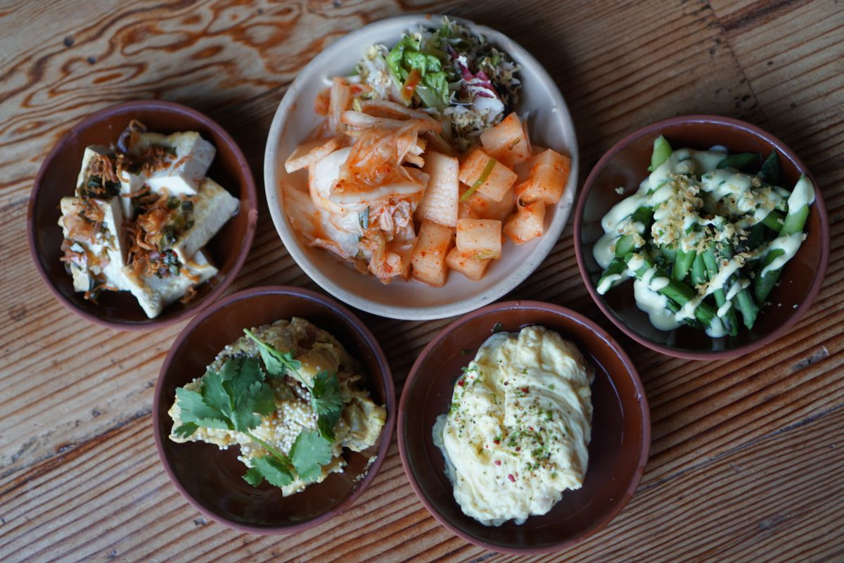From above, a series of Korean side dishes laid out on a table