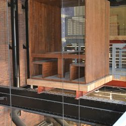 One of two floating tables hanging on the second floor and overlooking the bar downstairs.
