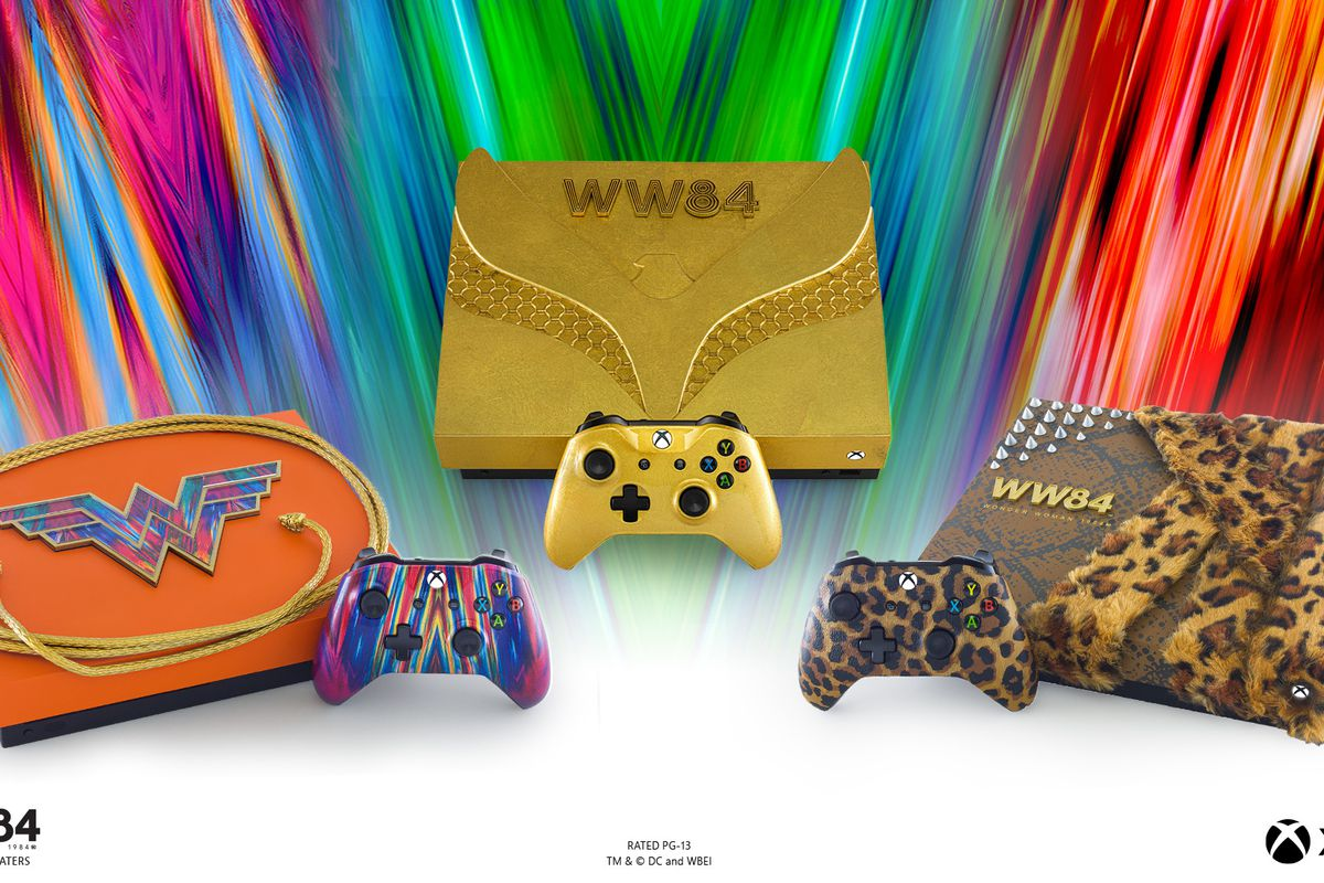 three swanky xboxes: one is a bright orange with the wonder woman logo, the other is gold with armor, and the third has a leopard print coat because why not