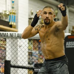 Robert Whittaker warms up during UFC 234 media workout.