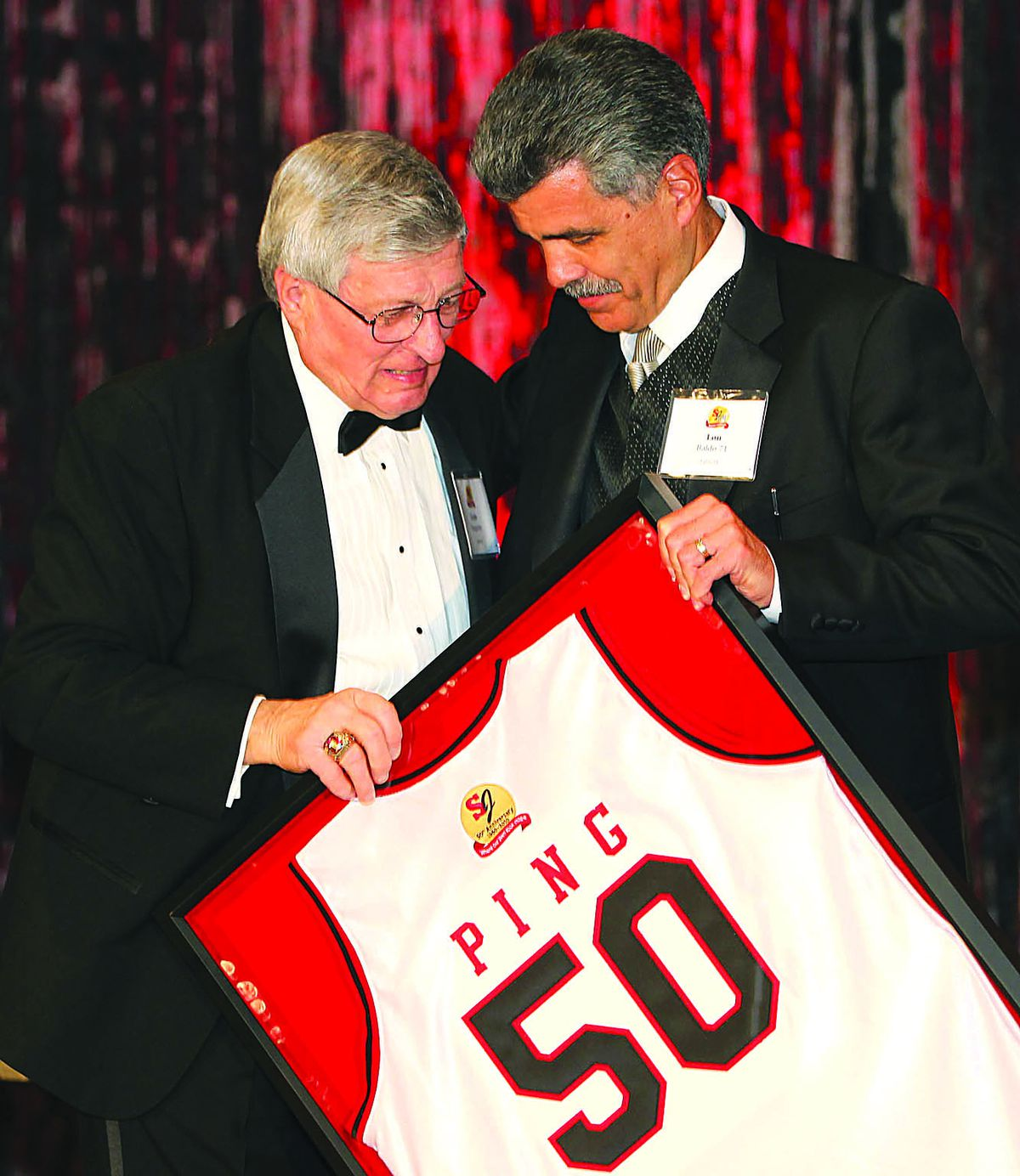 Lou Baldo presents a framed jersey to legendary basketball coach Gene Pigatore during the St. Joseph High School Golden Jubilee Gala.