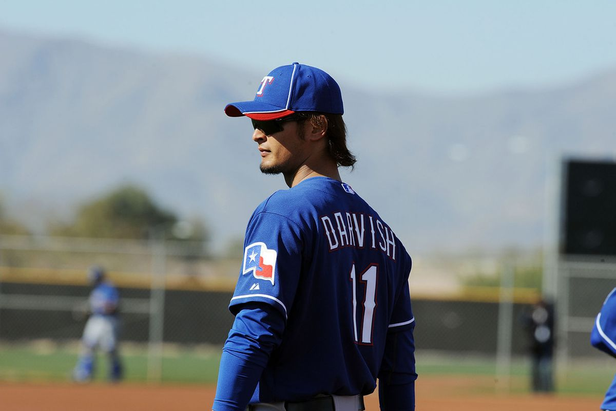 SURPRISE, AZ - FEBRUARY 23:  Yu Darvish #11 of the Texas Rangers takes the field during spring workouts at Surprise Stadium on February 23, 2012 in Surprise, Arizona.  (Photo by Norm Hall/Getty Images)
