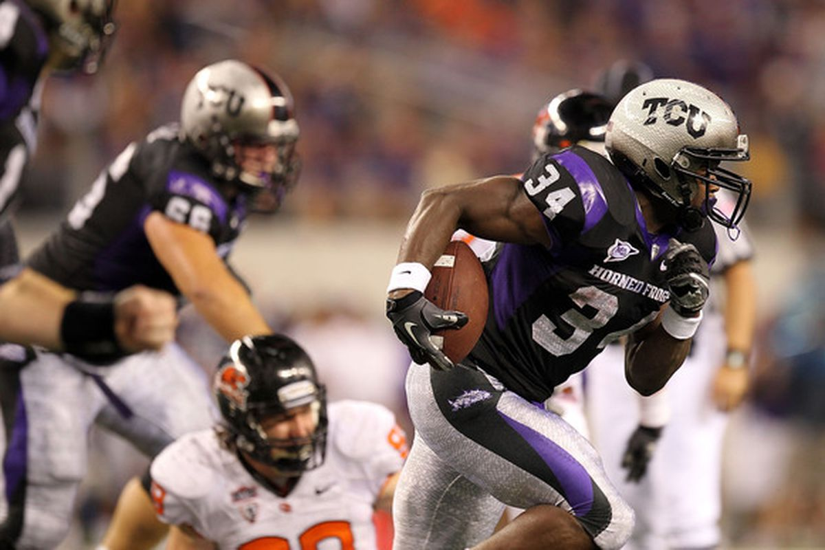 ARLINGTON TX - SEPTEMBER 04:  Tailback Ed Wesley #34 of the TCU Horned Frogs runs the ball against the Oregon State Beavers at Cowboys Stadium on September 4 2010 in Arlington Texas.  (Photo by Ronald Martinez/Getty Images)