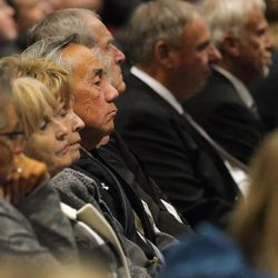 Norm Chow and others listen as family, friends and former team members gather to honor former BYU football coach LaVell Edwards at a memorial service at the Provo Convention Center on Friday, Jan. 6, 2017.