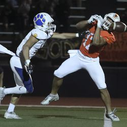 Orem's Isaac Yokota (11) breaks up a pass intended for Timpview's Pokai Haunga (17) at Timpview High in Provo on Thursday, Sept. 30, 2021.