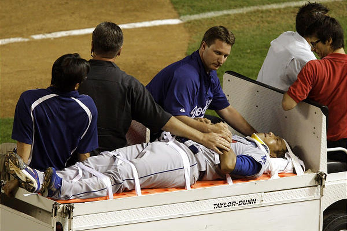 Los Angeles Dodgers' Hiroki Kuroda, of Japan, is carted off the field after being hit in the head by a line drive.