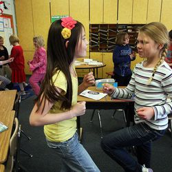 Kate Mason, left, and Lauryn Longmore exercise in Nicole Carter's class at Tolman Elementary School in Bountiful, Monday, Nov. 26, 2012.