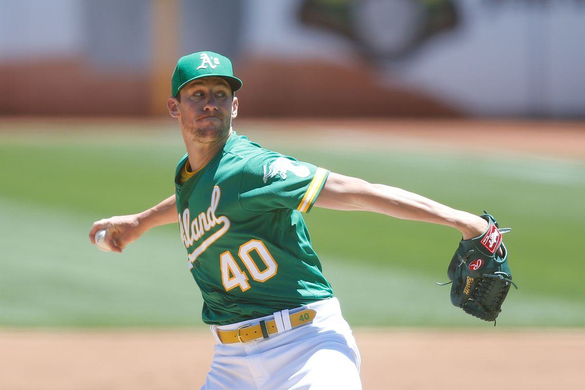 Chris Bassitt #40 of the Oakland Athletics pitches in the top of the second inning against the Kansas City Royals at RingCentral Coliseum on June 13, 2021 in Oakland, California.