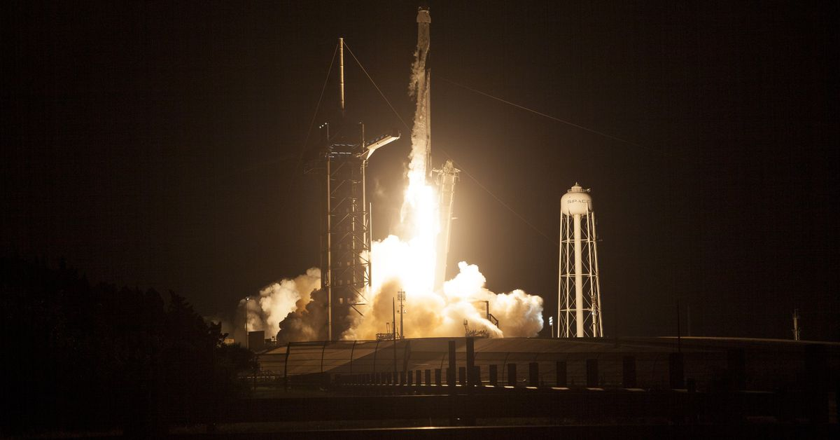 SpaceX capsule with four astronauts on board docks with the International Space Station