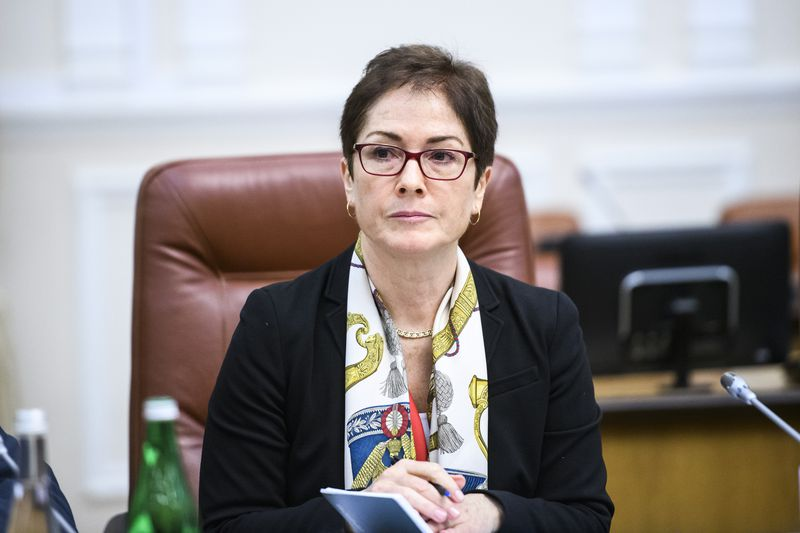 Ambassador Marie Yovanovitch seated listening in on a meeting.