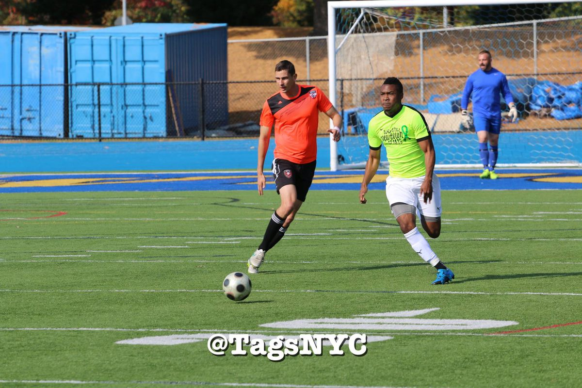 Players from GPS Omens (orange) and Newtown Pride FC (green) in USOC qualifying action from Sunday.