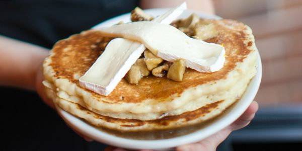 Giant pancakes topped with slices of brie
