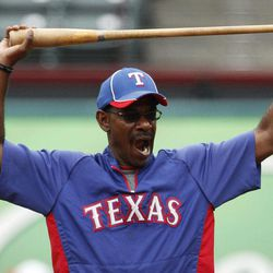 Texas Rangers manager Ron Washington (38) stretches as he stands in the infield during batting practice before a baseball game against the Seattle Mariners Saturday, Sept. 15, 2012, in Arlington, Texas.
