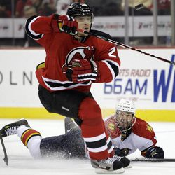 Florida Panthers' Marco Sturm, bottom, of Germany, falls while competing for the puck with New Jersey Devils' Anton Volchenkov, of Russia, during the first period of Game 6 of a first-round NHL hockey Stanley Cup playoff series, Tuesday, April 24, 2012, in Newark, N.J.