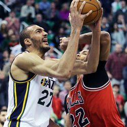 Utah Jazz center Rudy Gobert (27) takes a shot with Chicago Bulls forward Taj Gibson (22) defending during NBA basketball in Salt Lake City, Monday, Feb. 1, 2016.