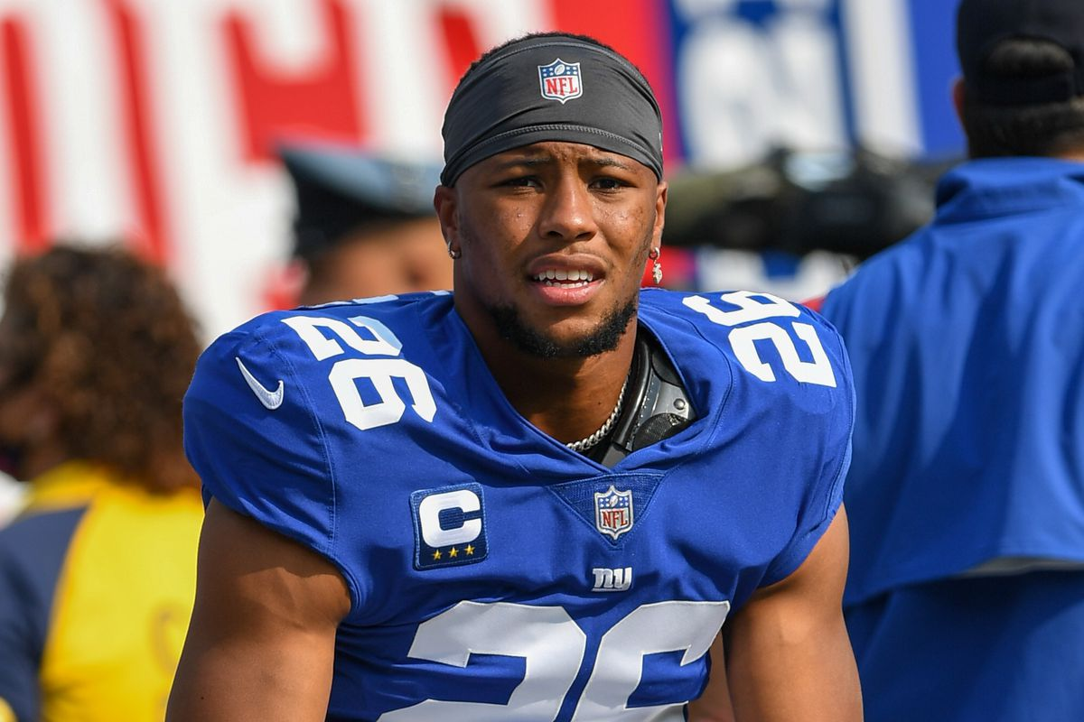 East Rutherford, New York Giants running back Saquon Barkley (26) warm up before the game against the Denver Broncos at MetLife Stadium.