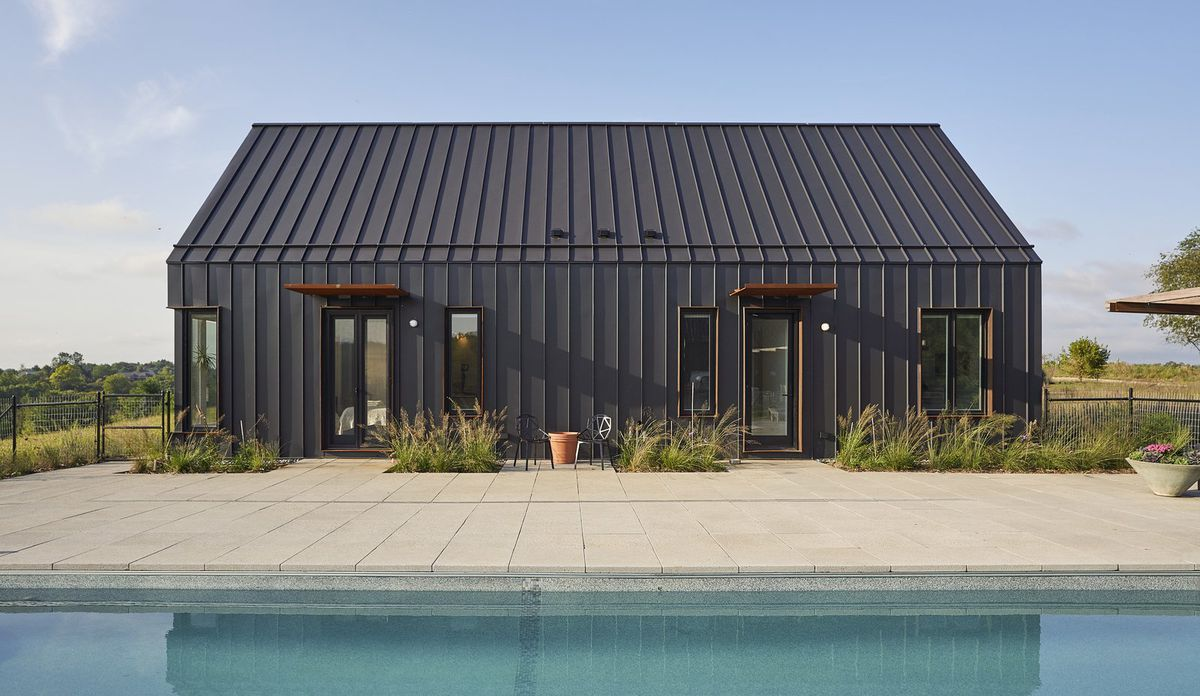 Exterior of house clad in black steel.