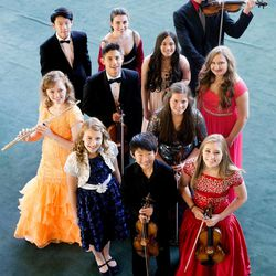 (Rear row, left to right) Alexander Cheng, Sally Drutman, and William Yavornitzky. (Orange dress, left) Ashley Fleming, Jeremy David Lewis, Rachel Aina Call,  Erika Hubbard and Mischael Ann Staples. (Blue and silver dress, left) Hannah Jean Baker, Soonyoung Kwon and McCall Andersen. These musicians, pictured July 30 at Abravanel Hall, have been selected to perform in this year's Salute to Youth concert.