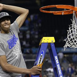 Kentucky forward Anthony Davis celebrates as he cuts the net after the NCAA Final Four tournament college basketball championship game Monday, April 2, 2012, in New Orleans.  Kentucky beat Kansas 67-59.