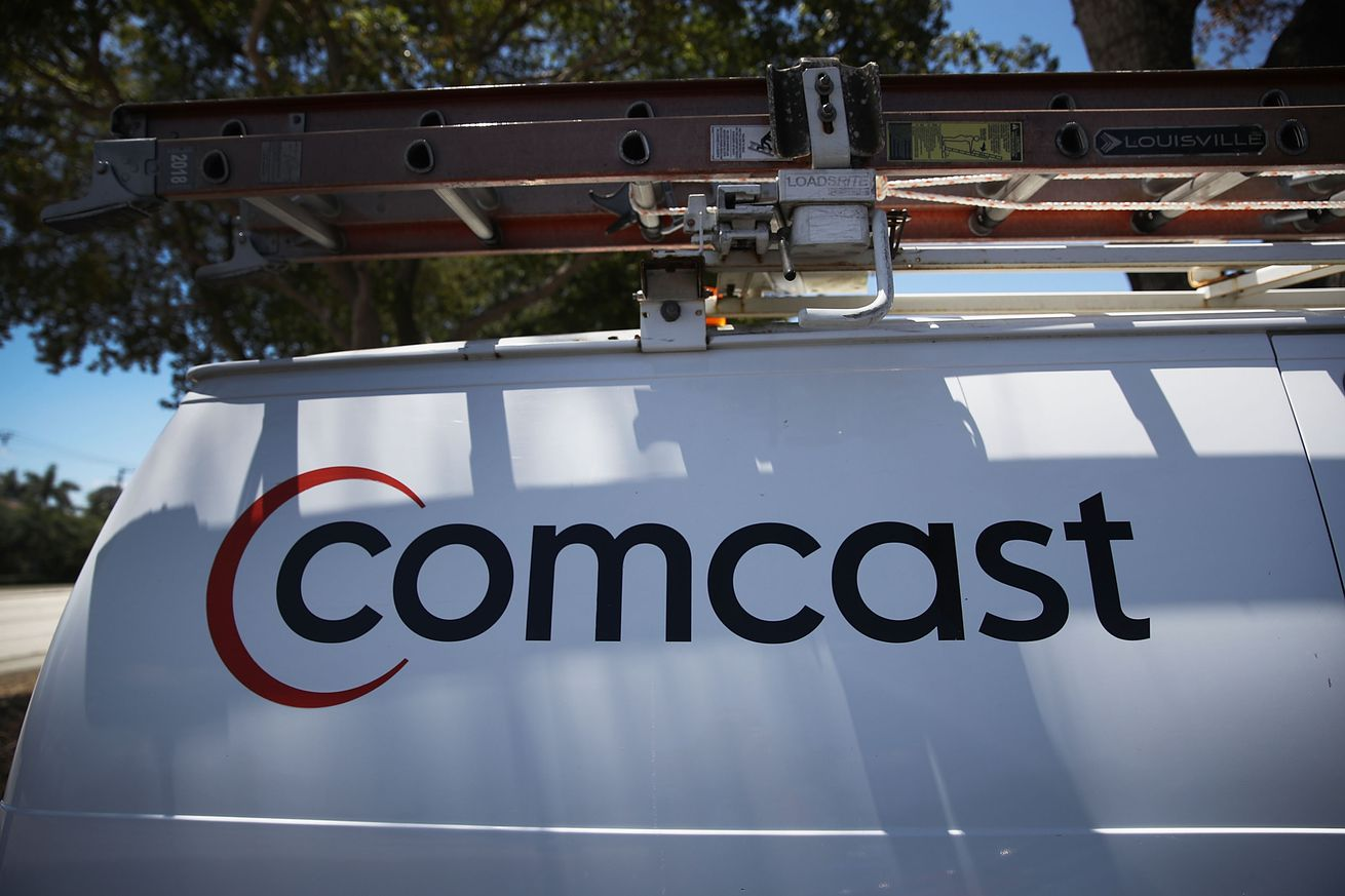 comcast says it won t throttle heavy internet users for now