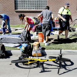 Salt Lake City police officer Cody Orgill asks homeless people to pack up their belongings on 500 West on Wednesday, Sept. 28, 2016. Police officers and Salt Lake County Health Department employees routinely clean up the area, but their efforts are short-lived.