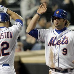 New York Mets' Kirk Nieuwenhuis (9) is greeted by teammate Scott Hairston (12) after scoring on a single by Lucas Duda during the eighth inning of a baseball game against the Miami Marlins on Tuesday, April 24, 2012, at Citi Field in New York.
