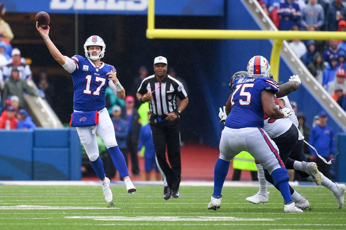 Buffalo Bills quarterback Josh Allen (17) passes the ball against the Houston Texans during the first half at Highmark Stadium.