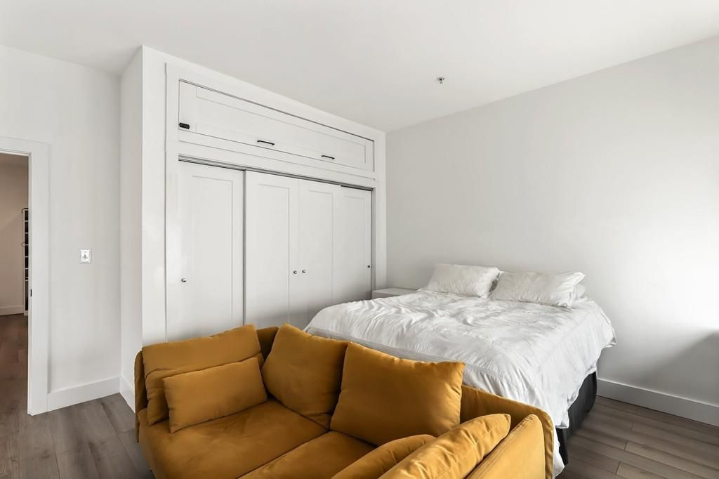 A bedroom with a bed and a closet.