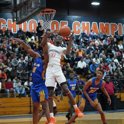 Simeon's Jeremiah Stamps (15) battles Young's Keenan Jones (3), Wednesday 02-13-19. Worsom Robinson/For the Sun-Times.