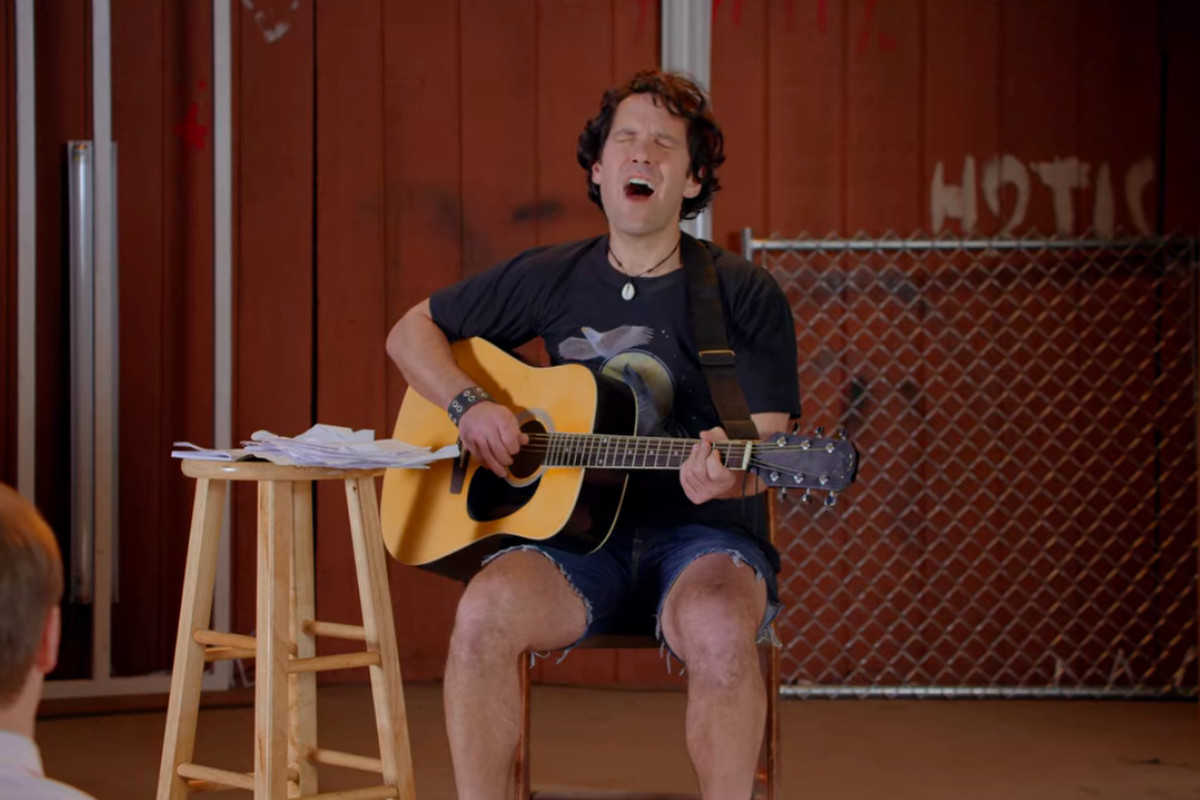 paul rudd sings a song on his guitar in wet hot american summer: first day at camp