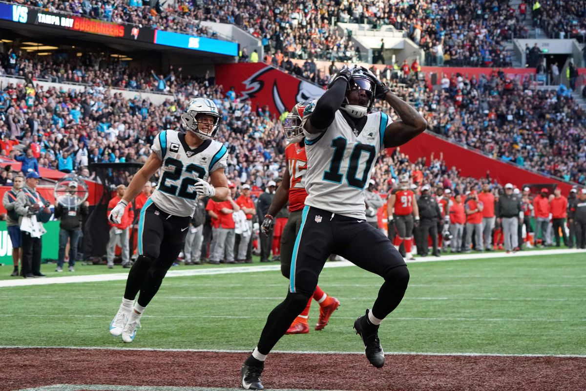Carolina Panthers wide receiver Curtis Samuel celebrates with running back T.J. Logan after catching a 13-yard touchdown pass against the Tampa Bay Buccaneers in the fourth quarter during an NFL International Series game at Tottenham Hotspur Stadium.