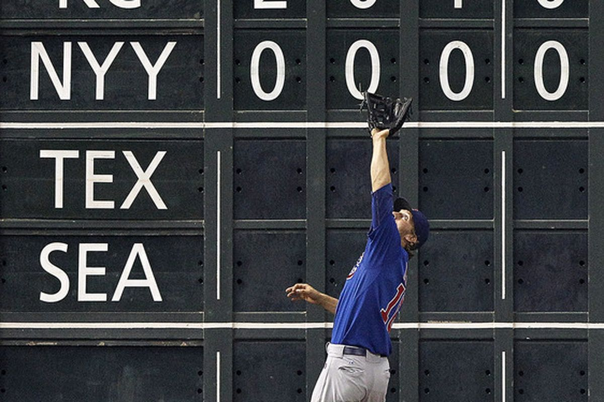 Joe Mather of the Chicago Cubs make a catch on a fly ball by Brian Bogusevic of the Houston Astros at Minute Maid Park in Houston, Texas.  (Photo by Bob Levey/Getty Images)