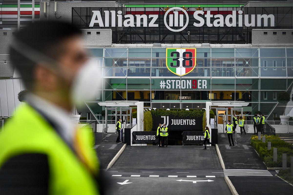 Stewards prepare the opening of the Allianz Stadium ahead...