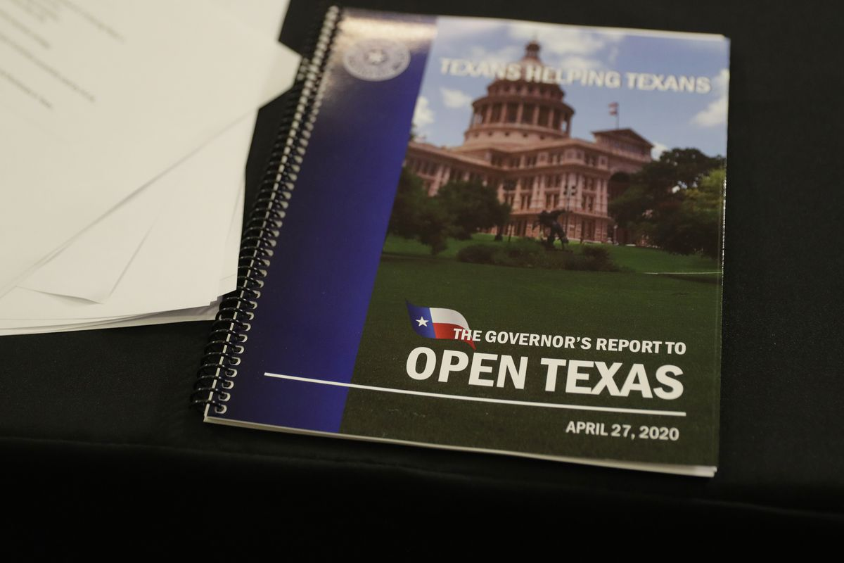 A copy of the Governor's Report to Reopen Texas is seen during a news conference where Gov. Greg Abbott announced he would relax some restrictions imposed on some businesses due to the COVID-19 pandemic, Monday, April 27, 2020, in Austin, Texas. (AP Photo/Eric Gay)