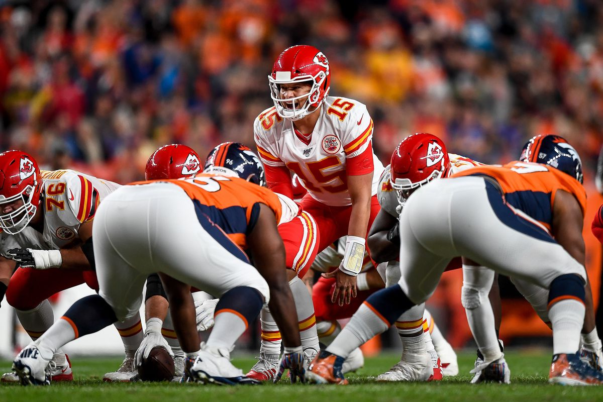 Patrick Mahomes of the Kansas City Chiefs runs the offense against the Denver Broncos in the second quarter of a game at Empower Field at Mile High on October 17, 2019 in Denver, Colorado.