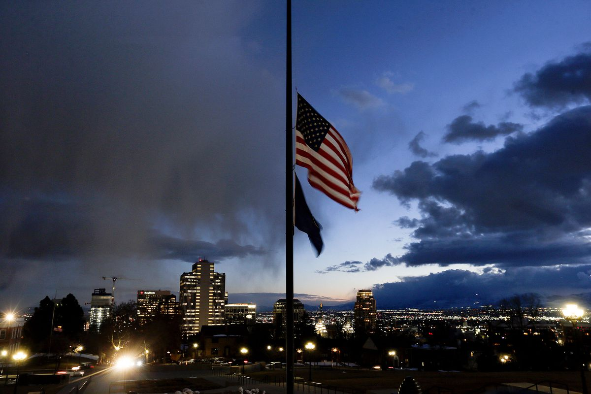 Flags fly at half-staff at the Utah Capitol to recognize those who died from COVID-19.