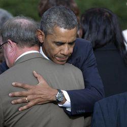 President Barack Obama comforts family members of victims during a memorial service for the victims of the Washington Navy Yard shooting at Marine Barracks Washington, Sunday, Sept. 22, 2013, in Washington.