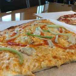 At SLABpizza, which has a locations in Lehi and  Provo,  customers can order slabs — one-fourth of a 20-inch pizza — in over 50 different varieties, including Buffalo wing and Three Meats.