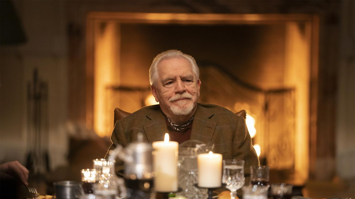Logan Roy (Brian Cox) sits at the head of a dining table in Succession