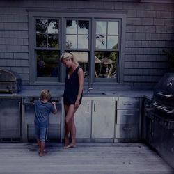 """Gwyneth and son via <a href=""""http://a1.twimg.com/profile_images/1360902500/Gwyneth.jpg"""" rel=""""nofollow"""">@gwynethpaltrow/Twitter</a>"""