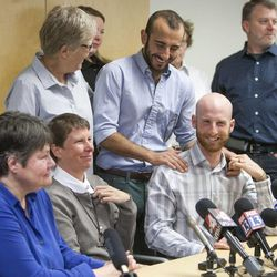 Same sex couples Kate Call, Kody Partridge, Laurie Wood, Moudi Sbeity and Derek Kitchen gather Monday, Oct. 6, 2014, in the office of Peggy Tomsic in Salt Lake City, after the Supreme Court refused to hear appeals on same sex marriages, making them legal.