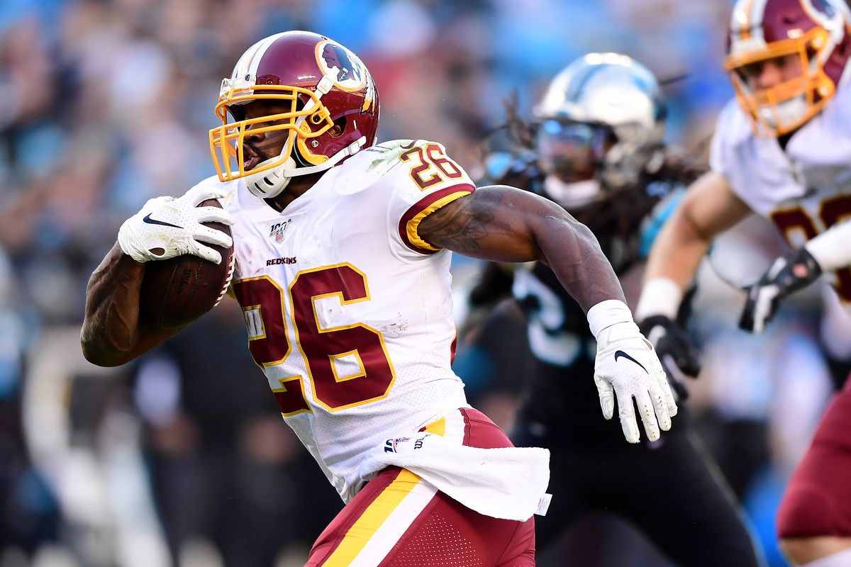 Adrian Peterson #26 of the Washington Redskins scores a touchdown during the fourth quarter during their game against the Carolina Panthers at Bank of America Stadium on December 01, 2019 in Charlotte, North Carolina.