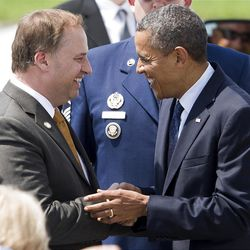 FILE - In this Wednesday, Aug. 1, 2012 file photo, Canton, Ohio Mayor William Healy greets President Barack Obama at the Akron Canton Airport in North Canton, Ohio. Obama was in the Akron area for a campaign stop. During the grim early days of 2010, when unemployment topped 13 percent, the budget was shrinking and pressures to meet payroll were mounting, he desperately needed help. The rescue, he says, came with millions of dollars in federal funds that Canton used to repair bridges, pave streets, demolish homes, hire workers and help keep police and firefighters on the job. (AP Photo/Jason Miller, File)